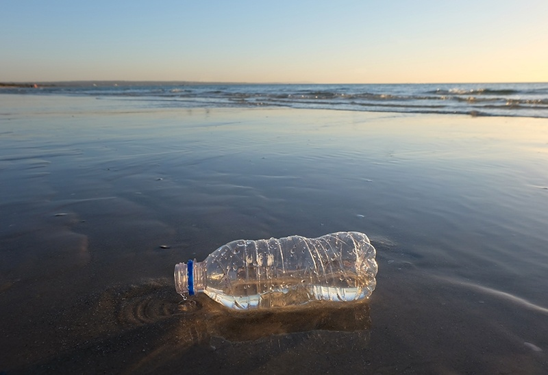 Water plastic bottle by the beach - G-873979628 2