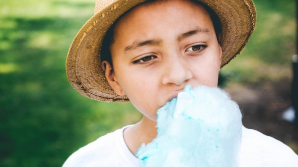 Boy eating candy floss