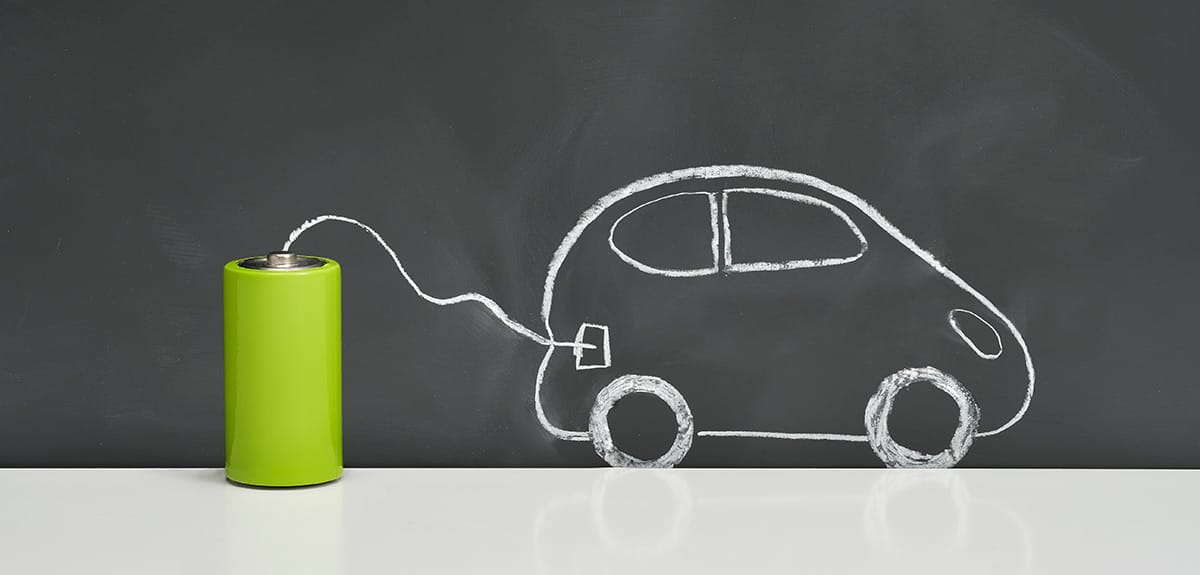 Electric car drawing power from battery